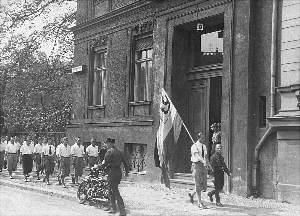 Nazi students parade in front of the Institute for Sexual Research in Berlin prior to pillaging it on May 6, 1933.